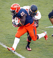 Virginia Cavaliers running back Kevin Parks (25) is tackled by Maryland Terrapins linebacker Marcus Whitfield (41) during the game against Maryland in Charlottesville, Va. Maryland defeated Virginia 27-20.
