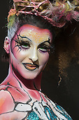 London, UK. 11 April 2015. Portrait of the model Caroline Can who displays a full bodypainting design by makeup artist Mylène Ruaux. United Makeup Artists Expo (UMAe),  the UK's leading aspiring and professional hair and makeup artist trade show, gets underway at the Business Design Centre in Islington, London, UK. It runs until Sunday, 12 April. At this trade show leading professionals provide demonstrations and the latest techniques and products are showcased.