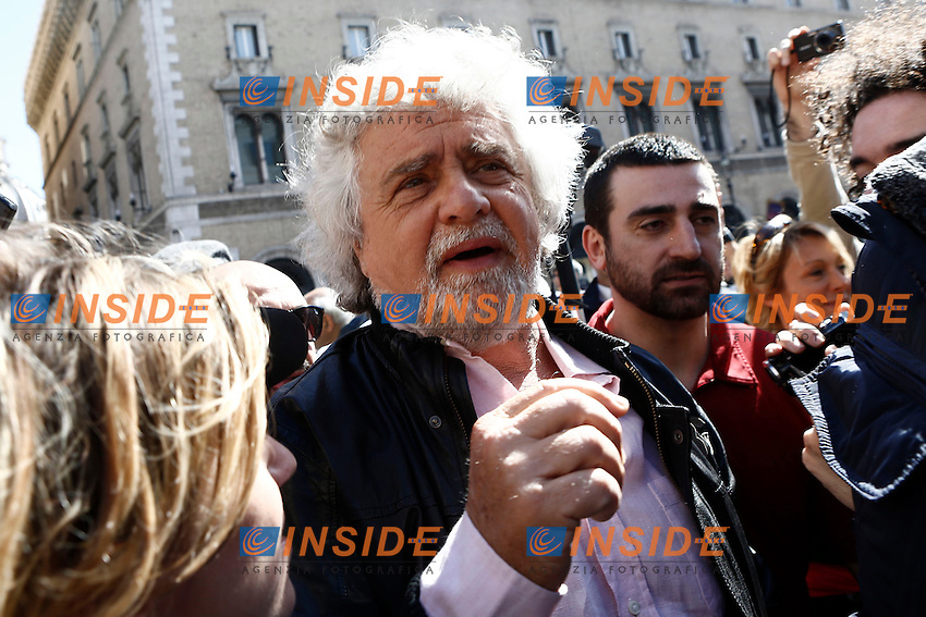 Beppe Grillo sale su una macchina per salutare la gente .Beppe grillo jumps over a car to greet people.Roma 21/04/2013. Piazza Santi Apostoli, manifestazione organizzata dal Movimento 5 Stelle contro l'elezione di Napolitano a Presidente della Repubblica.Demonstration of the Movement 5 Stars against the re-election of Napolitano.Photo Matteo Minnella/Oneshot/Insidefoto