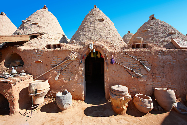 "Pictures of the beehive adobe buildings of Harran, south west Anatolia, Turkey.  Harran was a major ancient city in Upper Mesopotamia whose site is near the modern village of Altınbaşak, Turkey, 24 miles (44 kilometers) southeast of Şanlıurfa. The location is in a district of Şanlıurfa Province that is also named ""Harran"". Harran is famous for its traditional 'beehive' adobe houses, constructed entirely without wood. The design of these makes them cool inside. 15"