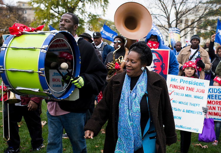 UNITED STATES - NOVEMBER 12: Rep. Sheila Jackson Lee, D-Texas, walks with striking Federal Contract Workers as they march to the Capitol to call for higher wages on Thursday, Nov. 13, 2014. (Photo By Bill Clark/CQ Roll Call)