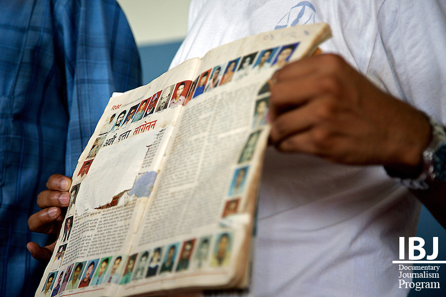 Remembrance.  A magazine containing photographs of disappeared citizens was displayed while a song was sung in their memory during the August 30th program, International Day of the Disappeared Program, Pokhara, Nepal International Day of the Disappeared program in Pokhara Nepal