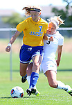BROOKINGS, SD - AUGUST  22: Diana Potterveld #7 from South Dakota State University is taken down by Sydney Born #3 from Green Bay in the first half of their game Sunday afternoon at Fischback Soccer Field in Brookings. (Photo by Dave Eggen/Inertia)