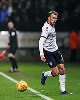 Bolton Wanderers' Christian Doidge keeps the ball in play<br /> <br /> Photographer Andrew Kearns/CameraSport<br /> <br /> The EFL Sky Bet Championship - Bolton Wanderers v Leeds United - Saturday 15th December 2018 - University of Bolton Stadium - Bolton<br /> <br /> World Copyright &copy; 2018 CameraSport. All rights reserved. 43 Linden Ave. Countesthorpe. Leicester. England. LE8 5PG - Tel: +44 (0) 116 277 4147 - admin@camerasport.com - www.camerasport.com