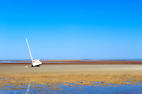 Sailboat on a tidal flat, Brewster, Cape Cod, MA, USA