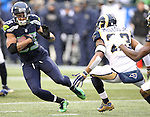 Seattle Seahawks wide receiver Doug Baldwin (89) gains yardage after catching a pass against the St. Louis Rams at CenturyLink Field in Seattle, Washington on December 27, 2015.  The Rams beat the Seahawks 23-17.      ©2015. Jim Bryant Photo. All Rights Reserved.