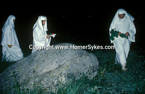 Druids celebrate the summer solstice at Stonehenge Wiltshire June 21st dawn sunrise. England. Perform traditional rituals and rites.<br /> <br /> William Roach aka Ken Barlow, an actor from Coronation Street. (r)
