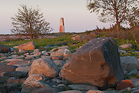 Sunrise highlights Nature's elements -rocks and trees- at Lyökki day beacon on Pookinmaa Island off the Baltic's Southwestern Finland. It is Finland's oldest beacon built of stone in 1757.