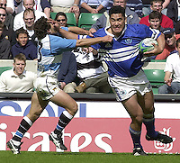 25/05/2002 (Saturday).Sport -Rugby Union - London Sevens.Samoa vs Argentina.Matias Albina hand's off Lucio Lopez Fleming[Mandatory Credit, Peter Spurier/ Intersport Images].