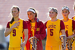 Los Angeles, CA 02/09/13 - Carley Horan (USC #9), Kelsey Davey (USC #4), Justina Burns (USC #5) and Eggy Plastaras (USC #34)  stand for the national anthem before the inaugural game against Northwestern.