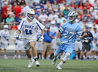 Annapolis, MD - May 20, 2018: Duke Blue Devils Terry Lindsay (11) is defendind Johns Hopkins Blue Jays Thomas Guida (27) during the quarterfinal game between Duke vs John Hopkins at  Navy-Marine Corps Memorial Stadium in Annapolis, MD.   (Photo by Elliott Brown/Media Images International)