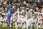 Auburn celebrates after making a last second field goal to win the game 37-34 against UK at Commonwealth Stadium on Saturday, Oct. 9, 2010. Photo by Scott Hannigan | Staff