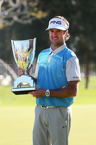 21.02.2016. Pacific Palisades, California, USA.  Bubba Watson holds up the winners trophy  after winning the Northern Trust Open at Riviera Country Club in Pacific Palisades, CA.