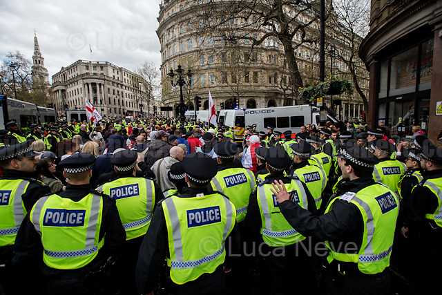 EDL.<br /> <br /> London, 01/04/2016. Today, two British far-right extremist groups, Britain First and the EDL (English Defence League), held two separate marches and rallies in reaction to the recent Westminster terror attack in a &lsquo;designated area&rsquo; between Trafalgar Square, Whitehall and Victoria Embankment. A counter-demonstration was called by the Anti-Fascist Network, London Antifascists and Unite Against Fascism (UAF) to oppose the extremist right-wing racist rhetoric and exploitation of the attack by attributing responsibility to Muslim communities and migrants. A heavy riot police presence (with the aid of an helicopter, police horses and dogs) was in the area trying to keep the three factions separated: the EDL in a Whitehall pub and Britain First moved directly to the Embankment. The situation for the anti-fascist groups was different, while they were trying to march from Trafalgar Square to their designated area in Embankment close to the Ministry of Defence HQ, police imposed Section 14 (As explained in a Police information lefleat called: &quot;Police Information UAF Protest&quot; - see IMG_4859), arresting and taking away several left-wing activists. The anti-fascist rally was decimated by this police tactic, leaving a very small counter rally to confront the two extreme right-wing groups. <br /> <br /> To learn more about Section 14 - Public Order Act 1986 please read the PDF attached at the end of this story or please click here for the whole Public Order Act 1986: http://www.legislation.gov.uk/ukpga/1986/64