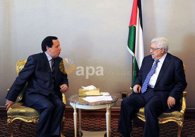 Palestinian President Mahmoud Abbas (Abu Mazen) meets with the Tunisian writer of Secretary of State and Minister of Foreign Affairs, khamees Aljhenawi in Doha on Aug. 23, 2011. Photo by Thaer Ganaim