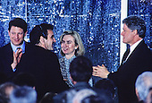 United States President Bill Clinton, right, greets performer Mandy Patinkin, left center, following a performance on the South Lawn of the White House in Washington, D.C. during a reception the evening prior to the dedication of the U.S. Holocaust Museum on April 21, 1993.  Looking on are U.S. Vice President Al Gore, left, and First lady Hillary Rodham Clinton, right center.<br /> Credit: Ron Sachs / CNP