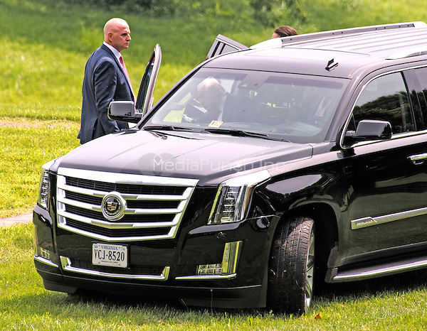 An unidentified security person holds the door of an SUV for Donald Trump (visible through the windshield), a candidate for the 2016 Republican nomination for President of the United States, as he arrives to appear at the ribbon cutting for the Albemarle Estate at the Trump Winery in Charlottesville, Virginia on Tuesday, July 14, 2015. <br /> Credit: Ron Sachs / CNP/MediaPunch<br /> <br /> (RESTRICTION: NO New York or New Jersey Newspapers or newspapers within a 75 mile radius of New York City)