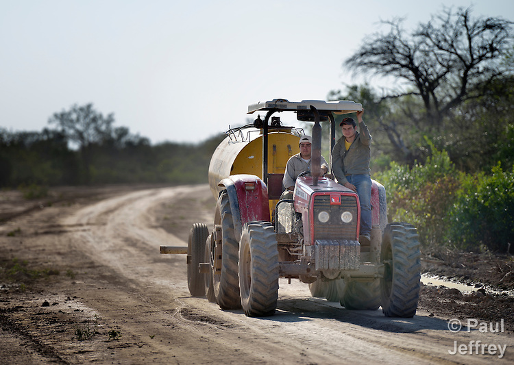 Water is a critical issue in the Chaco region in northern Argentina. Here a pair of men from the municipal government of Santa Victoria Este deliver water to a parched rural community.