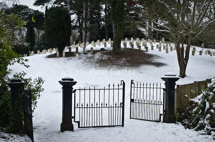 Snow covered graves, ?Netley Military Cemetery, ?Netley Abbey, Southampton, Hampshire. 10/01/10