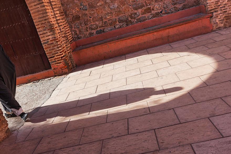 Man walks into the Koutoubia mosque in Marrakech, Morocco.