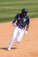 Wisconsin Timber Rattlers outfielder Je'Von Ward (4) races to third base during a Midwest League game against the Burlington Bees on April 28, 2019 at Fox Cities Stadium in Appleton, Wisconsin. Wisconsin defeated Burlington 5-4. (Brad Krause/Four Seam Images)