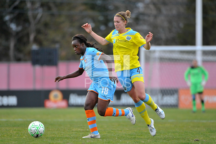 Eniola Aluko (18) of Sky Blue FC gets past Jen Buczkowski (4) of the Philadelphia Independence. The Philadelphia Independence and Sky Blue FC played to a 2-2 tie during a Women's Professional Soccer (WPS) match at Yurcak Field in Piscataway, NJ, on April 10, 2011.