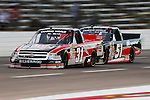 Camping World Truck Series driver James Buescher (31) leads Chad Hackenbracht (51) during the NCWTS Winstar World Casino 400 race at Texas Motor Speedway in Fort Worth,Texas.