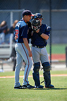 Atlanta Braves Zack Soria (11) talks with pitcher Alan Rangel (32) during a Minor League Spring Training game against the Detroit Tigers on March 22, 2018 at the TigerTown Complex in Lakeland, Florida.  (Mike Janes/Four Seam Images)