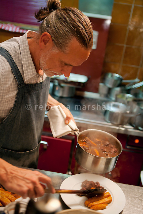 Chef Dominique le Stanc serves Provençal speciality beef daube at his restaurant La Merenda, Nice, France, 16 October 2013.