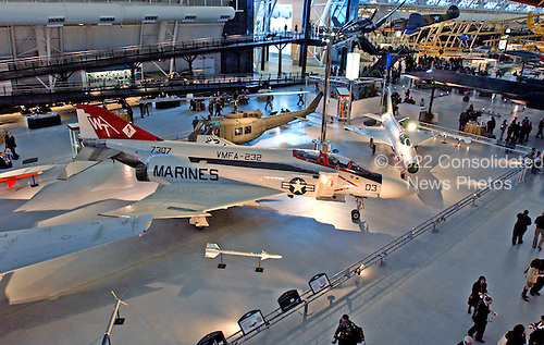 "Chantilly, VA - December 11, 2003 -- A McDonnell F-4S Phantom II is on display with a Bell UH-1H Iroquois ""Huey"" helicopeter, background center, and a MiG-21F ""Fishbed C"" , left at the Steven F. Udvar-Hazy Center in Chantilly, Virginia on December 11, 2003.  The ""Phantom II"" has been fliwn by the United States Air Force, Navy and Marine Corps as well as the air forces of 12 other nations.  In this aircraft, then known as a Navy F-4J, on May 18, 1972, Commander S.C. Flynn and his radar intercept officer Lieutenant W.H. John shot down a MiG-21 with a sidewinder air-to-air missile.  This fighter was later assigned to the Marine Corps and was extensively modernized and carried the new designation F-4S..Credit: Ron Sachs / CNP.(RESTRICTION: NO New York or New Jersey Newspapers or newspapers within a 75 mile radius of New York City)"