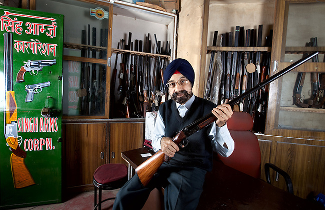 Charan Pal Singh Ghei, Secretary General of the All India Arms Dealers Association showing off part of his stock; an Indian manufactured Bharat double barrelled, 12 gauge shotgun at his Old Delhi gun shop. pic Graham Crouch for The Times