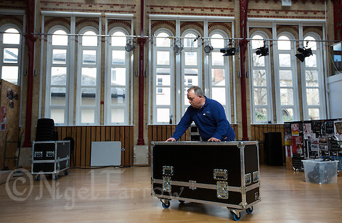 11 APR 2015 - STOWMARKET, GBR - John Peel Centre for Creative Arts sound engineer Phillip Radley wheels sound equipment through the building before the Larkin Poe gig in Stowmarket, Great Britain (PHOTO COPYRIGHT © 2015 NIGEL FARROW, ALL RIGHTS RESERVED)