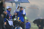 Graeme McDowell tries to dry his grip in the torrential rain on the 1st hole during the morning Fourball Match 2  during Day 1 of the The 2010 Ryder Cup at the Celtic Manor, Newport, Wales, 29th September 2010..(Picture Eoin Clarke/www.golffile.ie)
