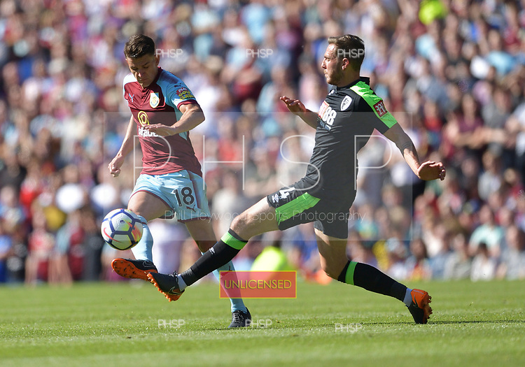 13/05/2018 Premier League Burnley v AFC Bournemouth<br /> <br /> Ashley Westwood avoids a challenge by Dan Gosling