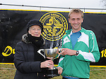 Bernadette McGuill wife of the late Larry McGuill presents a trophy in Larry's honour to winner Landon Peacock USA at Rás nahÉireann held at Oldbridge estate. Photo: Colin Bell/pressphotos.ie