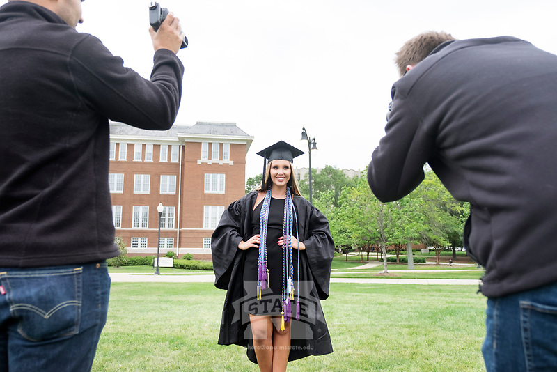 Kinesiology graduates taking photos on the Drill Field.<br />  (photo by Megan Bean / &copy; Mississippi State University)