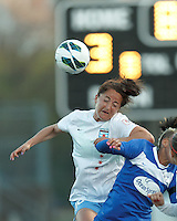 Chicago Red Stars defender Jackie Santacaterina (18) heads the ball.  In a National Women's Soccer League Elite (NWSL) match, the Boston Breakers (blue) defeated Chicago Red Stars (white), 4-1, at Dilboy Stadium on May 4, 2013.