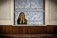 Kashmri muslim woman cries as she prays at a shrine of a sufi saint in Srinagar as the main duty to observe the holy month of Ramadan. As the tradition is attended muslims has to fast from dawn to dusk, where they refrain from eating, drinking and smoking.