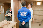 Plastering students with an instructor, Able Skills, Dartford, Kent.