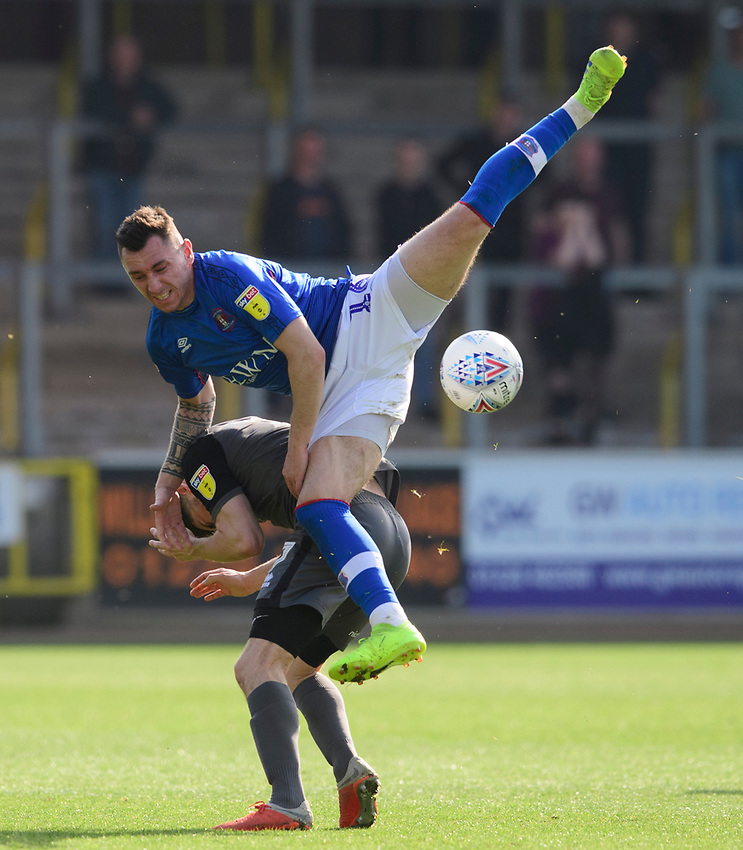 Lincoln City's Tom Pett vies for possession with Carlisle United's Nathan Thomas<br /> <br /> Photographer Chris Vaughan/CameraSport<br /> <br /> The EFL Sky Bet League Two - Carlisle United v Lincoln City - Friday 19th April 2019 - Brunton Park - Carlisle<br /> <br /> World Copyright © 2019 CameraSport. All rights reserved. 43 Linden Ave. Countesthorpe. Leicester. England. LE8 5PG - Tel: +44 (0) 116 277 4147 - admin@camerasport.com - www.camerasport.com