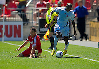 10 July 2010: Colorado Rapids forward Omar Cummings #14 and Toronto FC defender Dan Gargan #8 in action during a game between the Colorado Rapids and Toronto FC at BMO Field in Toronto..Toronto FC won 1-0.