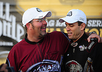 Nov 14, 2010; Pomona, CA, USA; NHRA top fuel dragster driver Larry Dixon (right) celebrates with crew chief Jason McCulloch after winning the 2010 top fuel championship during the Auto Club Finals at Auto Club Raceway at Pomona. Mandatory Credit: Mark J. Rebilas-