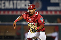 Harrisburg Senators catcher Pedro Severino (4) in a rundown during a game against the New Hampshire Fisher Cats on July 21, 2015 at Metro Bank Park in Harrisburg, Pennsylvania.  New Hampshire defeated Harrisburg 7-1.  (Mike Janes/Four Seam Images)