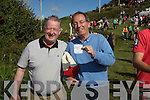 Winning ticket Dr. Brian Donovan on the right with Dermot Walsh at the Cahersiveen races on Sunday.
