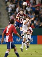 Chivas USA defender Jonathan Bornstein (13) goes high to head the ball during the first half of the game between Chivas USA and Toronto FC at the Home Depot Center in Carson, CA, on October 9, 2010. Final score Chivas USA 3, Toronto FC 0.