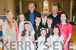 Rebecca Murphy, Ellie Mai Walsh, Aimee Browne. Middle row: Therese Kearney Principal, Grace O'Callaghan, David breja and Joel Smith and Marian O'Donnell, back Monsignor Dan and Canon denis O'Mahony