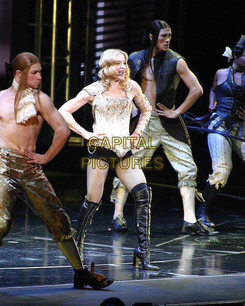 "MADONNA.On her ""Re-Invention"" tour performs live in concert at Madison Square Garden, New York,USA,.23rd June 2004..full length singing gig music on stage black hotpants over the knee boots gold beaded bodice corset top fishnet tights.www.capitalpictures.com.sales@capitalpictures.com.©Capital Pictures"