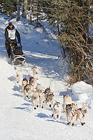 Musher Jerry Sousa on Long Lake at the Re-Start of the 2011 Iditarod Sled Dog Race in Willow, Alaska.