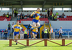 Gary Brennan of Clare leaps over the bench before their Munster championship quarter-final game against Limerick in Cusack park. Photograph by John Kelly.