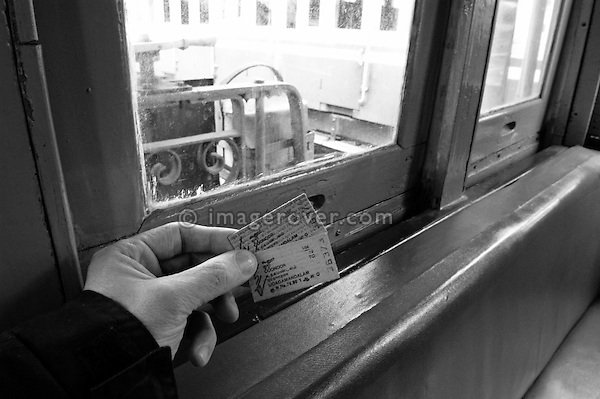 Two old style tickets for a trip on the Nilgiri Mountain Railway from Coonoor to Ooty. India, Tamil Nadu, Coonoor 2005. --- Info: The Nilgiri Mountain Railway (NMR) is the only rack railway in India and connects the town of Mettupalayam with the hill station of Udagamandalam (Ooty), in the Nilgiri Hills of southern India. The construction of the 46km long meter-gauge singletrack railway in Tamil Nadu State was first proposed in 1854, but due to the difficulty of the mountainous location, the work only started in 1891 and was completed in 1908. This railway, scaling an elevation of 326m to 2,203m and still in use today, represented the latest technology of the time. In July 2005, UNESCO added the NMR as an extension to the World Heritage Site of the Darjeeling Himalayan Railway.
